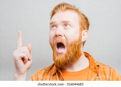 emotional and people concept: young bearded man with good idea sign.