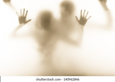 emotional picture of man and woman standing behind the milk glass