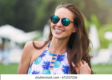 emotional portrait of a beautiful smiling woman with braces