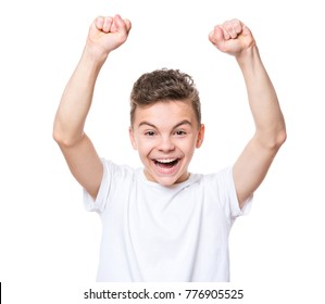 Emotional portrait of caucasian teen boy. Victory screaming teenager wearing white t-shirt, isolated on white background. Funny winner child shouting with his hands up.