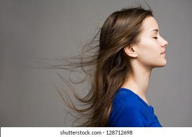 Emotional portrait of dreamy young brunette model.