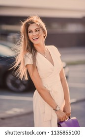 emotional portrait of Fashion stylish sexy of  young hipster blonde woman, elegant lady, bright colors dress, cool  girl. City view  urban lifestyle background.