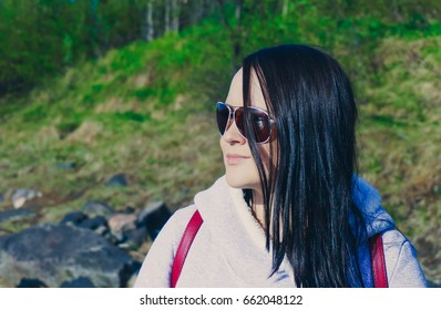 Emotional portrait girl in sunglasses on nature.
