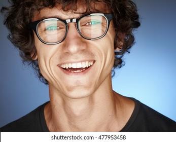 Emotional portrait of a pretty man on a blue background