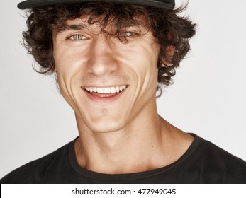Emotional portrait of a pretty young man with cap