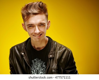 Emotional portrait of a teenager on a yellow background