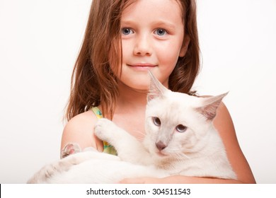 Emotional portrait of a young girl with her cat.