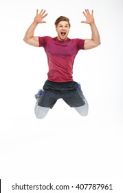 Emotional sporty jumping man isolated on a white background.
