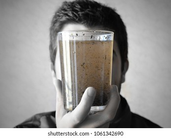 Emotional stress. Confused mind. Anxiety. Conceptual metaphor shows person with glass of cloudy and unclear water symbolizing the stressed mind.