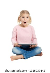 Emotional surprised girl with digital tablet computer PC, looking at camera, isolated on white background
