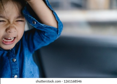 Emotional Tantrum and Angry little girl in the car.Mad kid got upset and sad and she has a negative attitude.Depressed little girl complaining.Attention deficit hyperactivity disorder (ADHD) Concept.