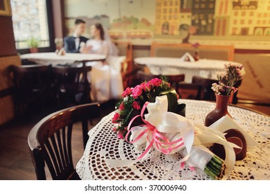 Emotional wedding couple in cafe having fun together.