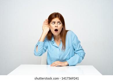 Emotional woman eavesdropping desktop spying