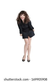 emotional woman posing in studio, wearing short dress.