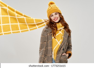 Emotional woman with a scarf around her neck and a jacket with a hat on her head