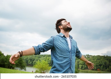 Emotional young man laughing in wind