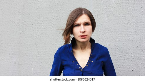 Emotional young woman. Suspicion, suspicious, violation of rules, violation of law, failure, violation, court, anxiety, guilt, guilty, search for meaning, search for oneself, indecisiveness.