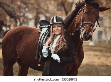 Emotional,happy,kind girl,lady,model with horse.Face,elegant.Closeup,amazing,activity,excellent long day in the horse park.Riding,standing near the mare in special uniform,woman with horse,happy,style