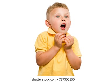Emotionally cheering kid. Hands gathered under the chin. Open mouth. Blond hair and bright eyes. White isolated background.