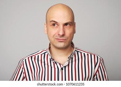 emotions of bald man. thoughtful man raising eyebrow