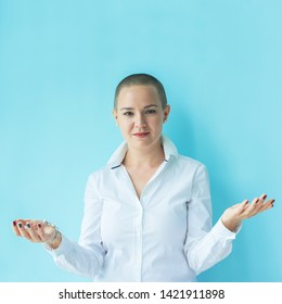 Emotions of goodwill, acceptance, invitation. Portrait confident beautiful happy young bald woman in white shirt on colored background wall. Human emotions facial expression concept