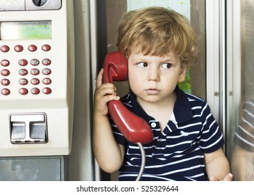The emotions of a little boy talking on the phone. A conversation on the landline. Emotions. The voice of the red handsets.