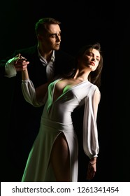 The emotions of romantic love. Couple in love with mime makeup. Mime man and woman act in romantic scene. Couple of mime artists perform romance on stage. Theatre actors miming through body motions.