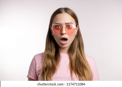 emotoional young fashion woman says Oh, no! . stunned, fascinated glamour girl with opened mouth. surpise, wonder, astonishment concept. isolated white background