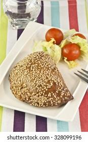 Empanada, patty with sesame