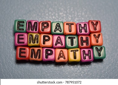Empathy word and letters spelled with colorful alphabet bead blocks.