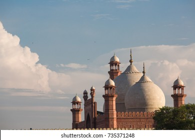The Emperor's Mosque - Badshahi Masjid in Lahore, Pakistan Dome with Minarets with mystical clouds