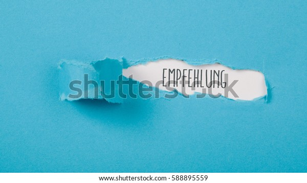 Empfehlung (German recommendation) message on torn blue paper revealing secret behind ripped opening.