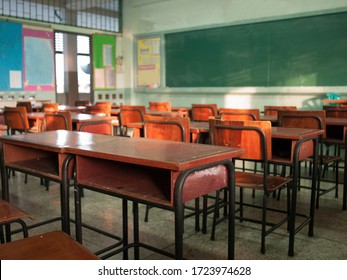 Emphasize primary level blur with no students, no children or teachers with chairs and desks only.
