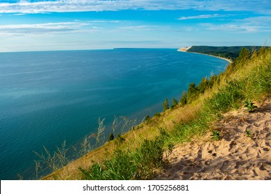 Empire Bluffs Scenic Lookout Facing Empire, Michigan in Sleeping Bear Dunes National Lakeshore on bright, sunny, and hot summer day. Great for day hikes and swimming. Bright green vegetation.