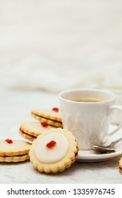 Empire shortbread sandwich cookies and cup of coffee