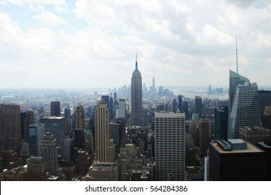 Empire state building centered and Manhattan behind