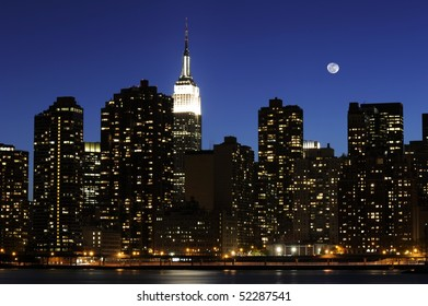 Empire State Building on a full moon night