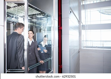 Employed people are traveling in an elevator downtown