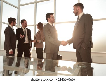 employee accepts congratulations from the boss