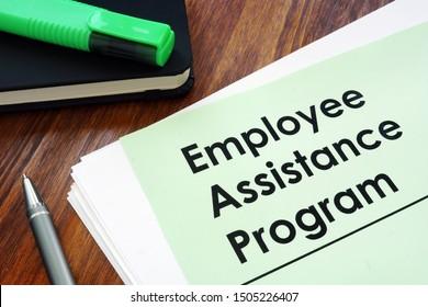 Employee assistance program EAP - benefit program on the desk.