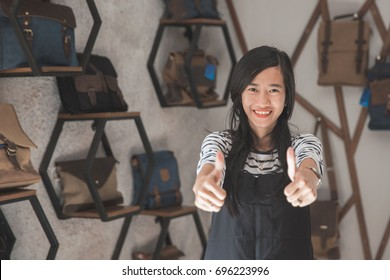 employee or business owner giving thumb up and smile