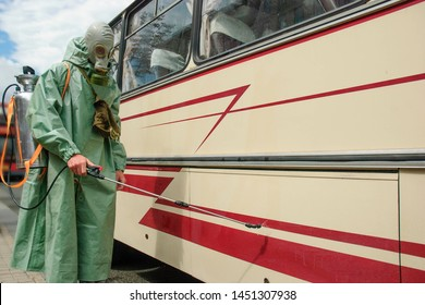 An employee of the Chernobyl Nuclear Power Plant conducts decontamination of the bus in the radiation control zone.