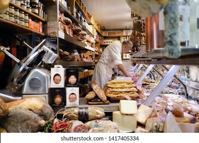 An employee in delicatessen shop in Rome, Italy on  April 29, 2019