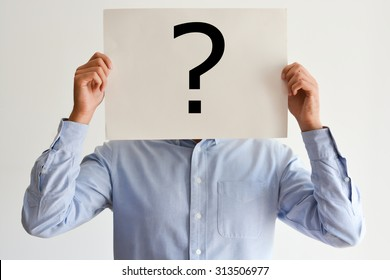 Employee dilemma with question marks on blank paper