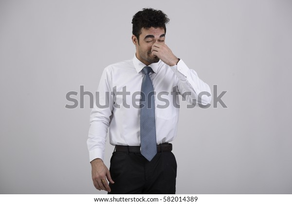 Employee with hand on the nose