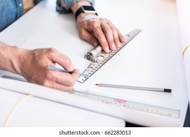 Employee making straight lines on paper