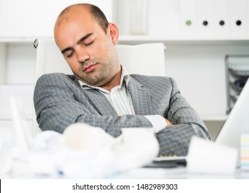 Employee man relax and sleeping in the modern office