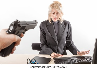 Employee on the menace of a gun during a bank robbery, white background, isolated.