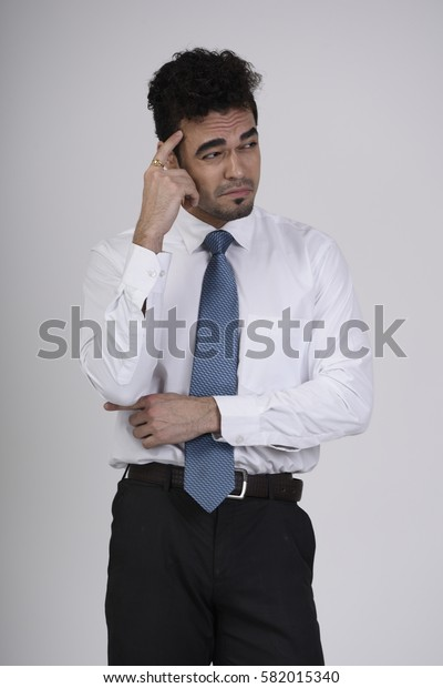 Employee with one hand on the head