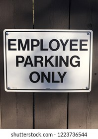 Employee Parking Only sign on wooden fence